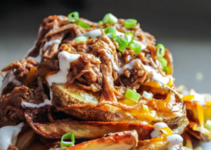 Cheesy Potato Wedges with Pulled Pork